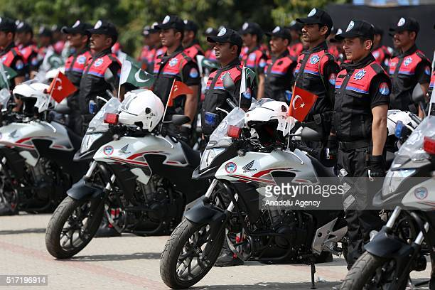 Motorcycle policemen are seen before they ride their motorcycles during their graduation ceremony at the Police Training Center in Lahore Pakistan on...