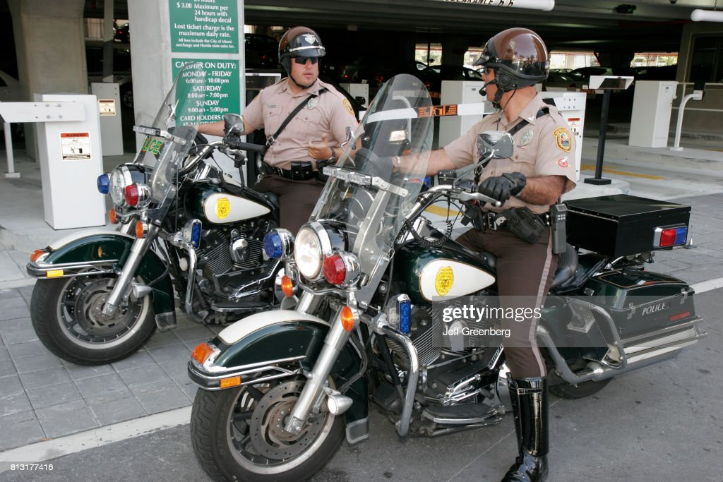 Motorcycle policemen outside the University of Miami Pictures ...