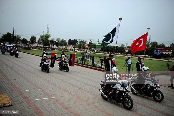 Motorcycle policemen ride their motorcycles during their graduation ceremony at the Police Training Center in Lahore Pakistan on March 24 2016 Chief...