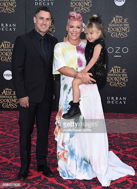 Motorcycle Racer Carey Hart singer Pink and daughter Willow Sage Hart arrive at the premiere of Disney's 'Alice Through The Looking Glass' at the El...