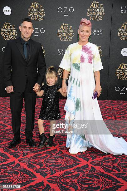 Motorcycle Racer Carey Hart Willow Sage Hart and singersongwriter Pink attend the premiere of Disney's 'Alice Through the Looking Glass' at the El...