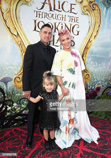 """Motorcycle Racer Carey Hart, Willow Sage Hart and singer-songwriter P!nk attend the premiere of Disney's """"Alice Through The Looking Glass at the El..."""