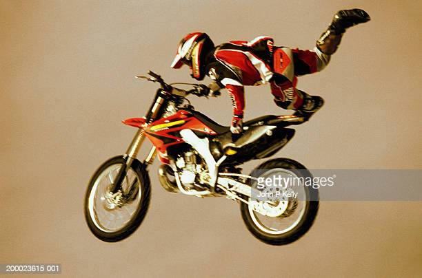 Motorcycle racer doing jump (blurred motion)