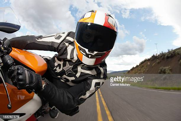 motorcycle racer going fast. - motorcycle racing stock pictures, royalty-free photos & images
