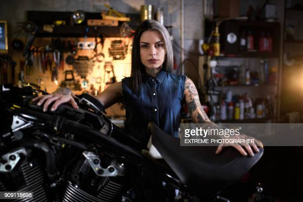motorcycle repair shop - electric motor stock photos and pictures