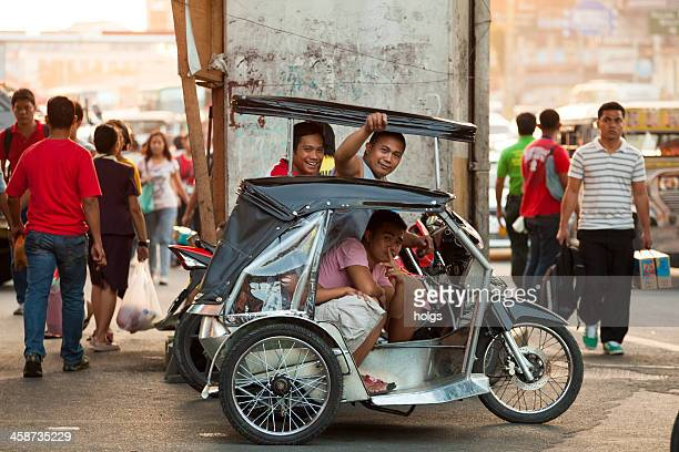 "motorcycle rickshaw known as a ""tricycle"" in metro manila - manila stock pictures, royalty-free photos & images"
