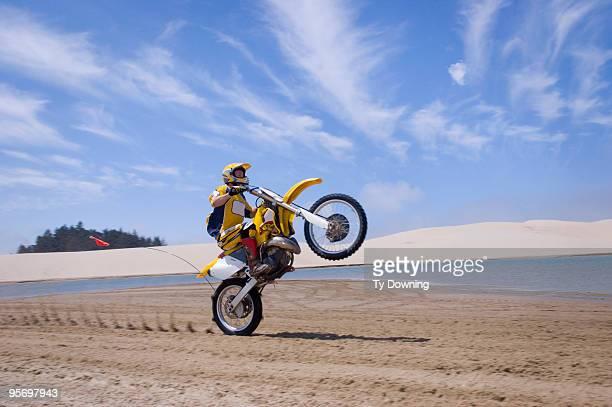 Motorcycle rider performing wheelie stunt