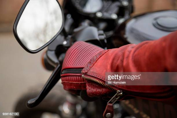 motorcycle rider - red jacket stock pictures, royalty-free photos & images