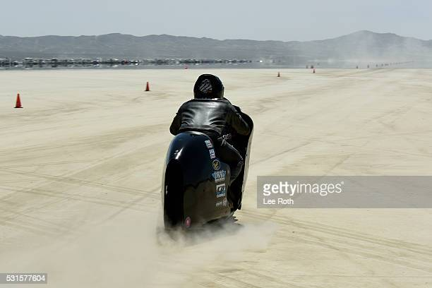 A motorcycle rider prepares for his run of 183341 mph at SCTA Southern California Timing Association's Land Speed Races 2016 Season Opening Day at El...