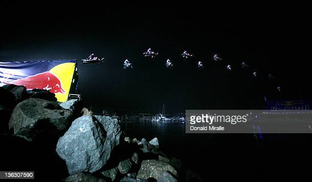 Motorcycle rider Robbie Maddison jumps 378 feet 9 inches and Snowmobile rider Levi LaVallee jumps 412 feet 6 inches to both break the current jump...