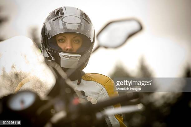 motorcycle rider standing in front of bike - バイクヘルメット ストックフォトと画像