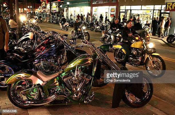 Motorcycle riders and enthusiasts take to the streets the night before the official kick off of Bike Week March 2 2006 in Daytona Beach FL More than...