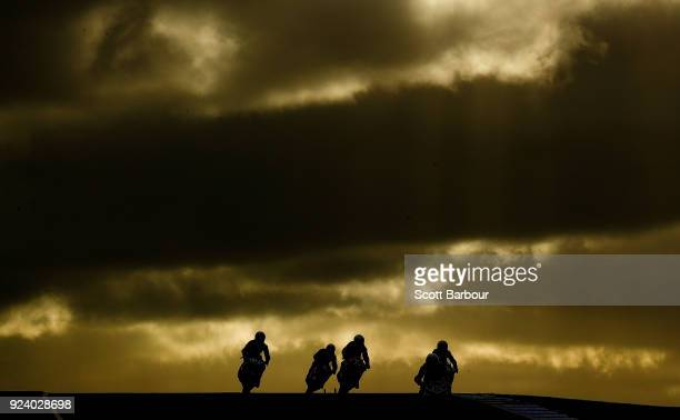 Motorcycle riders are silhouetted as they compete in the YMF R3 Cup race 3 ahead of the 2018 Superbikes at the Phillip Island Grand Prix Circuit on...