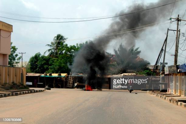 Motorcycle rides towards a bon fire set on the street over armed robbery attacks during the continued lockdown order at Olaniyi area of New Oko-Oba,...