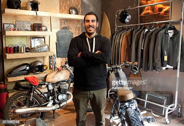 motorcycle shop owner in his showroom - three quarter length stock pictures, royalty-free photos & images