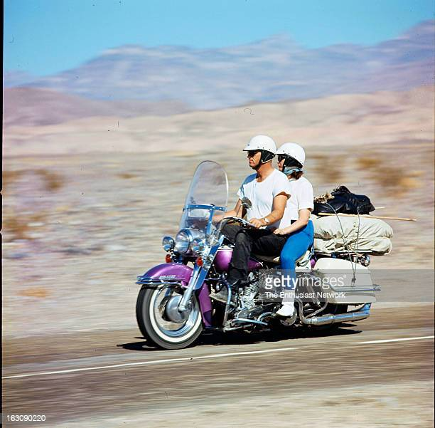 Motorcycle Sport Quarterly Cover A couple ride twoup on a HarleyDavidson DuoGlide with hard saddlebags and luggage rack packed with essentials