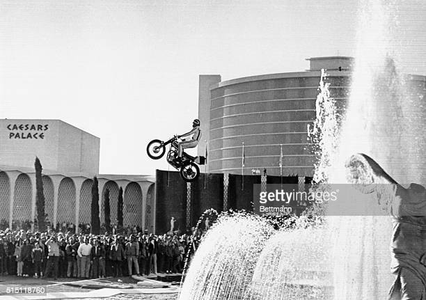 Motorcycle stunt man Evel Knievel jumping over the fountain at Caesars Palace in Las Vegas Nevada December 31 1967 He made the jump but crashed on...