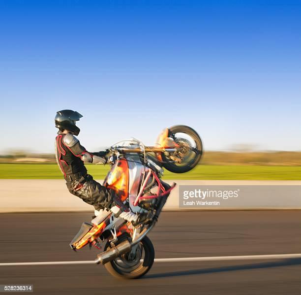 Motorcycle Stunt Rider Doing Wheelie on Sport Bike