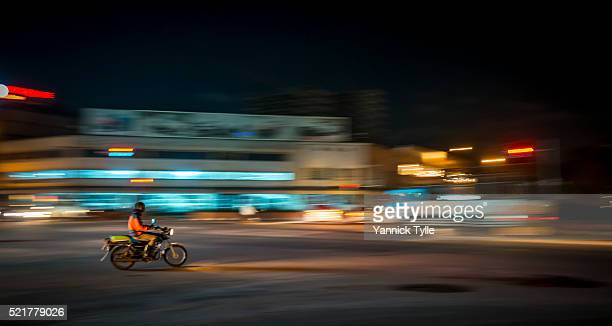 motorcycle taxi in kampala, uganda - kampala stock pictures, royalty-free photos & images