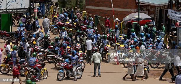 Motorcycle taxis called 'bodaboda' in East Africa wait for passengers at the Nyabugogo neighborhood bus park April 9 2014 in Kigali Rwanda Bodaboda...