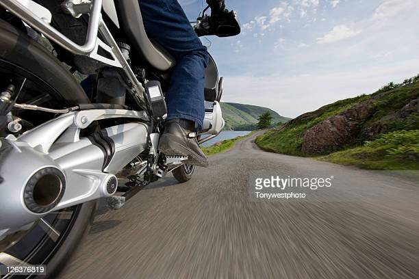 motorcycle touring alongside wastwater, the lake district, cumbria uk - progress stock pictures, royalty-free photos & images