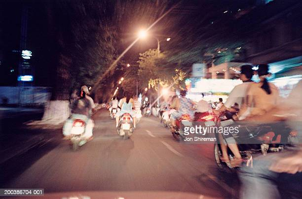 Motorcycle traffic, rear view, night