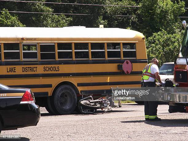 motorcycle under school bus - motorcycle accident stock pictures, royalty-free photos & images