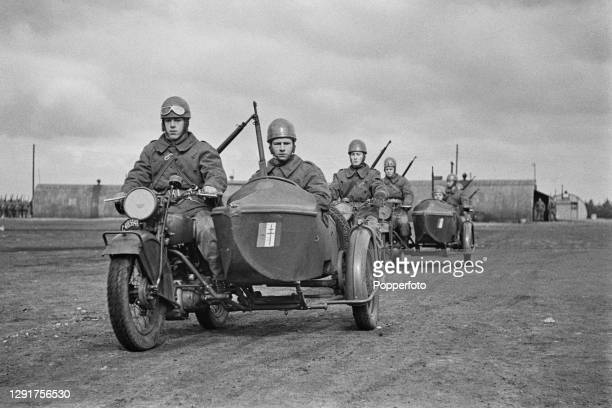 Motorcycle unit of Free French troops from a battalion of Chasseurs Alpins moutain forces ride from their base for a training exercise in England...