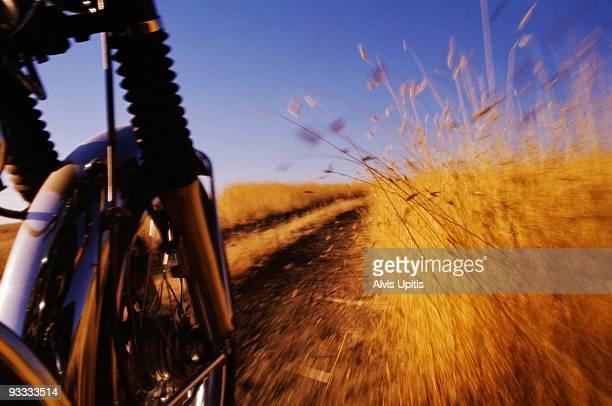Motorcycle wheel on rural dirt road