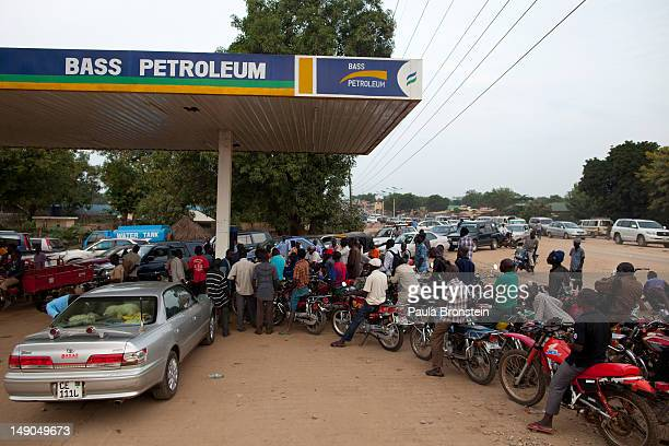 Motorcycles and cars line up for hours to get fuel before it runs out July 18 2012 in Juba South Sudan Fuel is always in short supply because of lack...