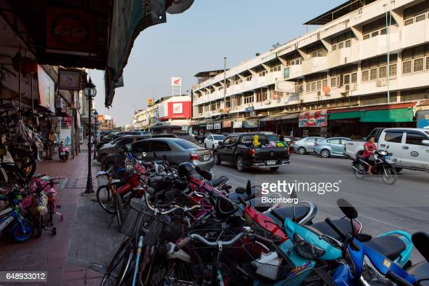 Motorcycles and cars sit parked along a street in Nan Nan Province Thailand on Friday March 3 2017 After more than a year of disinflation price...