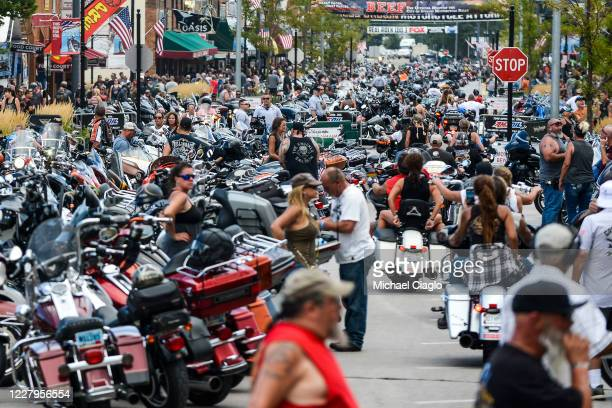 Motorcycles and people crowd Main Street during the 80th Annual Sturgis Motorcycle Rally on August 7 2020 in Sturgis South Dakota While the rally...