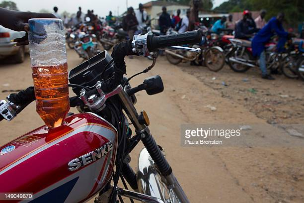 Motorcycles line up for hours to get fuel before it runs out July 18 2012 in Juba South Sudan Fuel is always in short supply because of lack of...