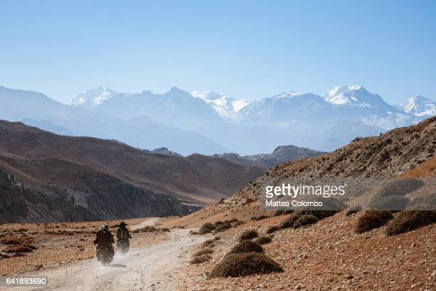 Motorcycles on dirt road, Upper Mustang region, Nepal
