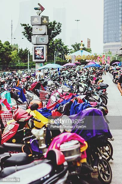 motorcycles parked at parking lot in city - parham emrouz stock pictures, royalty-free photos & images