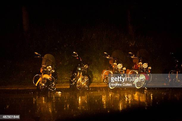 Motorcycles parked on the street sit through a latenight thunderstorm on the first day of the annual Sturgis Motorcycle Rally August 3 2015 in...
