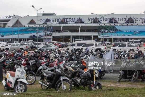 Motorcycles parked outside of the Phuket International Airport in Phuket, Thailand, on Sunday, Dec. 20, 2020. The tepid response to Thailands highly...