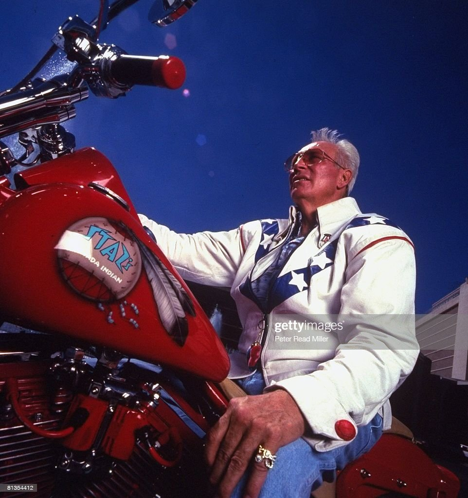 Portrait of former daredevil Evel Knievel sitting on motorcycle by fountain at Ceasar's Palace, Las Vegas, NV 9/12/1996