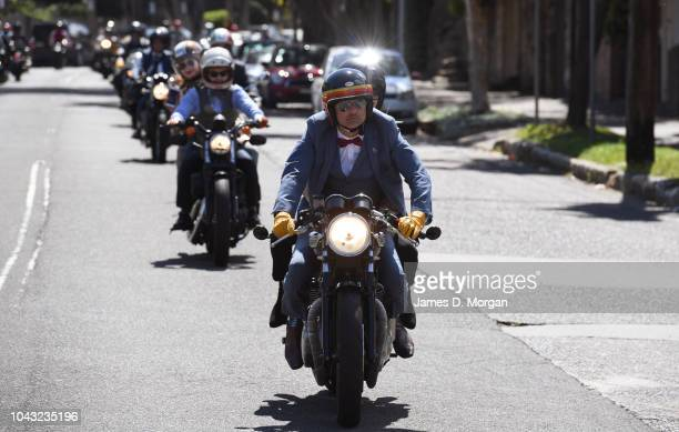 Motorcycliss travel down a hill in North Sydney during a charity ride on September 30 2018 in Sydney Australia The Distinguished Gentleman's Ride is...