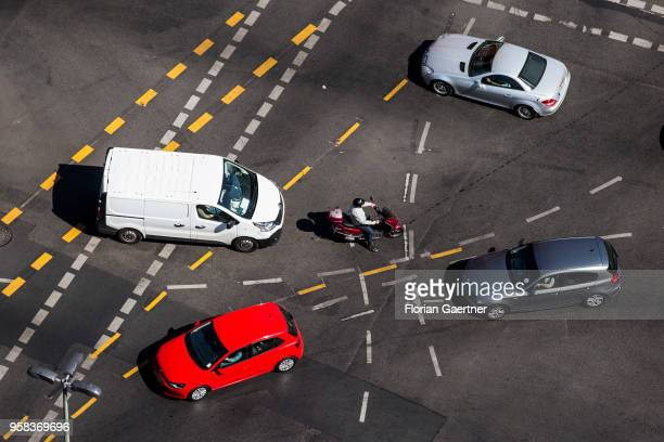 A motorcyclist and four cars are pictured on crossroads on May 09 2018 in Berlin Germany