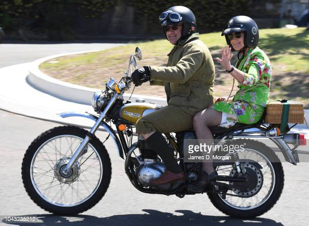 A motorcyclist and his female passenger wave and smile at onlookers during a charity ride on September 30 2018 in Sydney Australia The Distinguished...