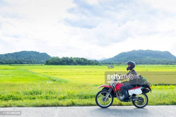 motorcyclist, camalaniugan, cagayan, philippines - philippines stock pictures, royalty-free photos & images
