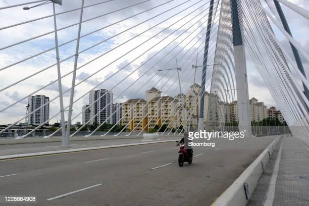A motorcyclist crosses the Seri PWawasan Bridge in Putrajaya Malaysia on Wednesday Sept 23 2020 Malaysias Prime Minister Muhyiddin Yassin urged...