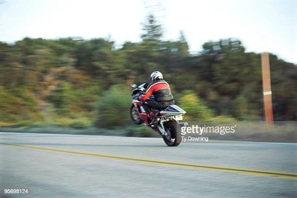 Motorcyclist doing a trick