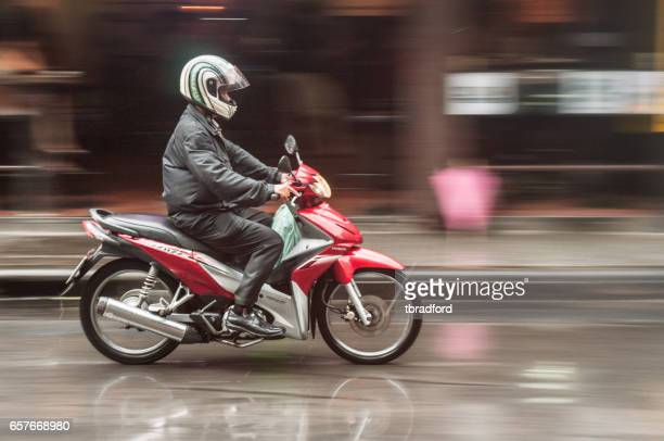 motorcyclist in bangkok, thailand - vespa brand name stock pictures, royalty-free photos & images
