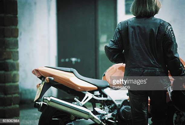 Motorcyclist in Black Leather with Motorcyle
