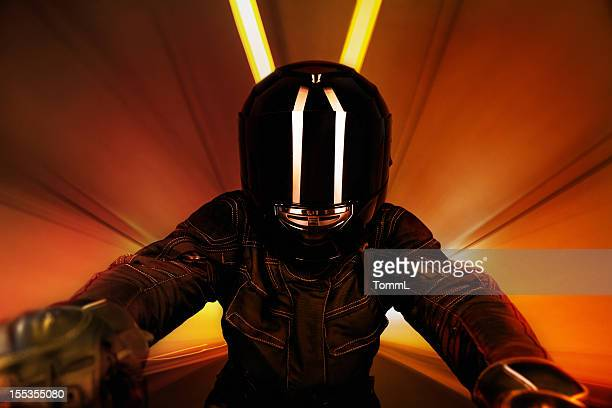 motorcyclist in tunnel - sports helmet stock pictures, royalty-free photos & images