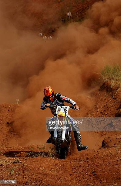 A motorcyclist makes his run up the hill climb competition at the Jackpine Gypsy Club Grounds during the 61st annual Sturgis Motorcycle Rally August...