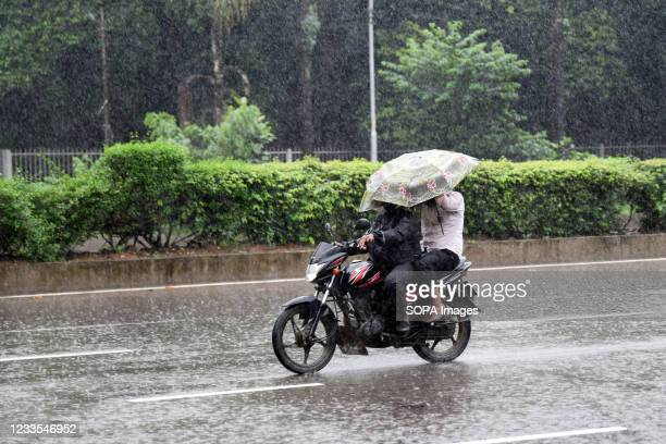 Motorcyclist makes his way during a rainfall on Manik mia avenue in Dhaka. Heavy monsoon downpour caused extreme water logging in most areas of Dhaka...