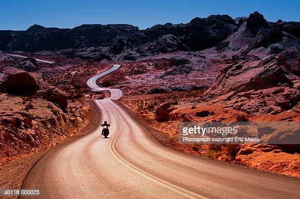 Motorcyclist on Empty Road
